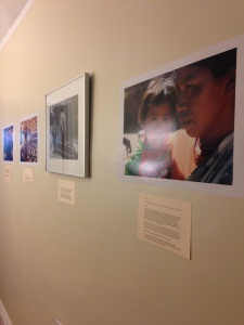 Photos line the walls at the ¡Buen Vivir! Gallery.