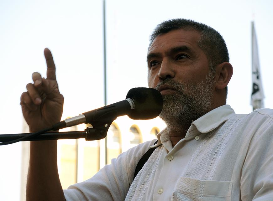 A spokesperson for the •Federación Nacional Campesina FNC speaks at the rally. PhotoLangelle