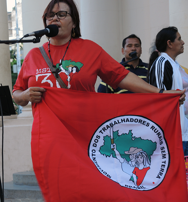 A woman speaks from the Brazil's Landless Workers Movement, Movimento dos Trabalhadores Rurais Sem Terra (MST). PhotoLangelle