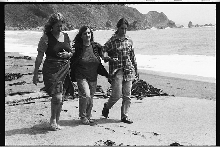 Judi Bari, center, walks on a Pacific Ocean beach in California with the support of two women friends  after a pipe-bomb ripped through her car in 1990 - See more at: http://photolangelle.org/blog-2/#sthash.H5VB3OGI.dpuf