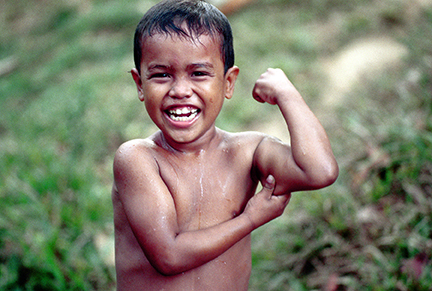 Young Nicaraguan boy displaying his commitment and hope for a good life. Photo: Langelle